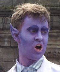 Only in Edinburgh during festival time...... (Joyce Waugh) Tags: portrait white face purple coat ears fringe lilac performer 2015