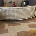 Floor tile being installed