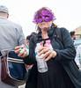 Turquoise - II (UrbanphotoZ) Tags: camera nyc newyorkcity woman ny newyork brooklyn coneyisland beads purple mask turquoise trenchcoat backpack pointandshoot earrings mermaidparade waterbottle eyemask flightbag