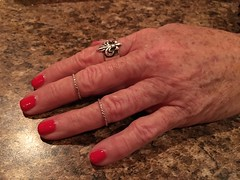 Rings on her fingers. (davidwilliamreed) Tags: rings freckles redfingernails andeeshand
