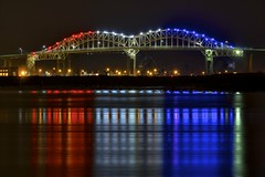 red, white, and blue (twurdemann) Tags: longexposure bridge winter colour reflection water architecture night unitedstates michigan upperpeninsula saultstemarie 30seconds soolocks internationalbridge northernmichigan stmarysriver ledlighting nikcolorefex 49783 tonalcontrast viveza detailextractor americansaultlocks stmarysfallscanal xf55200mm fujixt1