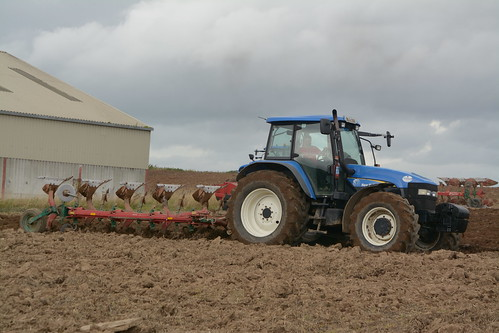 New Holland TM155 Tractor with a Kverneland 5 Furrow Plough