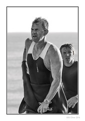 Showing the Young'uns The Way (Seven_Wishes) Tags: newcastleupontynenortheast whitleybay canoneos1dmarkiv canonef70200mmf28lisii sport people candid portrait sportportrait athlete athletic triathlon spanishcitytriathlon2016 outdoor photoborder blackandwhite mono monochrome wetsuit rubber vest watch dof depthoffield