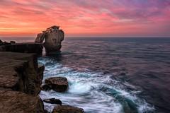 Pulpit Rock Sunrise (movinonagroove) Tags: rock sea seascape sunrise pink pulpit pulpitrock leefilter lee dorset portlandbill uk waves sun morning movement nikon