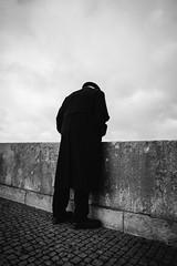 Facing the Leap (Thomas Listl) Tags: thomaslistl blackandwhite noiretblanc biancoenegro street man lonely urban sky depressing