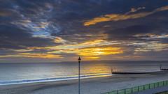 Sunset Clouds (nicklucas2) Tags: sunset sun seascape beach sea sand groyne cloud cloudsstormssunsetssunrises ray wave streetlight seaside