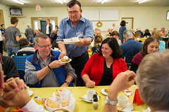 Donnie MacGregor, volunteer and member of St. David's United Church congregation, serves guests. (photo: Steve Wadden)