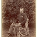 Young man seated in garden- Cabinet Card