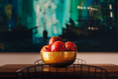 Pomegranate in gold bowl (J-nas) Tags: wood blue red holiday black color green table gold holidays fuji pomegranate fujifilm bertoia tabletop plating xf 56mm vsco