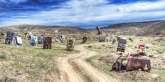 Road to Ruin (magnetic_red) Tags: road blue sky mountains color cars clouds landscape graffiti junk desert path nevada surreal dirt goldfield internationalcarforestofthelastchurch