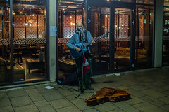 Sing a song of sixpence.... (Dafydd Penguin) Tags: busker street entertainer guitar player sing song singing after dark high iso night shots scene raw bristol harbourside harbor city urban centre watershed nikon df nikkor 35mm af f2d