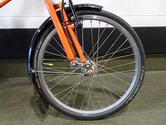 Flap (stevenbrandist) Tags: mudflap raw orange bicycle wheel mudguard continentalgrandprix tyre tsr spaceframe moulton moultonbicyclecompany