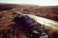 the street (Ron Layters) Tags: thestreet road goytvalley winter cold frost ice light landscape windingroad wall drystonewall moorland highpeak peakdistrict buxton england derbyshire unitedkingdom slidefilmthenscanned slide transparency fujichrome velvia leica r6 leicar6 ronlayters