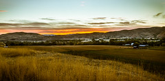 East End Of Emmett Valley (http://fineartamerica.com/profiles/robert-bales.ht) Tags: blue sunset red sky usa foothills house mountain mountains history nature beauty grass horizontal sunrise wow landscape dawn photo scenery butte unitedstates superb scenic dramatic peak panoramic farmland historic idaho boise valley land pacificnorthwest environment farms homestead drama sunrisesunset tranquil emmett rollinghills haybales stupendous treasurevalley gemcounty squawbutte emmettvalley robertbales fidaho