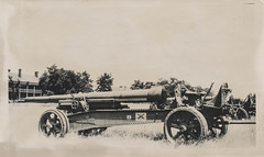 Large artillery sitting in a field (simpleinsomnia) Tags: world old white black monochrome field vintage found outside blackwhite war gun antique military wwii snapshot worldwarii photograph ii weapon artillery vernacular foundphotograph