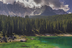 Emerald-green lake 'Carezza' (niekbraam) Tags: lagoon lake water green smaragd minerals forest mountain carezza mountainlake italy clouds trees pines travel outdoor clear
