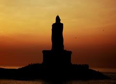 Tranquility (Harsh Mangal`) Tags: kanyakumari india thiruvalluvar thiruvalluvarstatue silhouette harshmangal sunrise dawn tamilnadu colours bayofbengal arabiansea indianocean confluenceofseasandocean sea ocean water statue