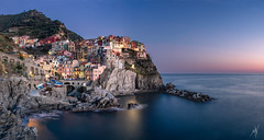 Manarola (Mat Viv) Tags: canon sigma sigma1750mmf28 sigmalens sigma1750mm wideangle longexposure lowlight landscape skyscape sea seaside seascape sunsetlight sunset sun sunlight nature natural naturallight manarola travel italy liguria cinqueterre outdoors architecture citylights city cityscape horizon sky clearsky twilight dusk blue bluehour water waves coast cliffs foam panorama panoramic view