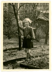 Girl with School Cone, 1955 (Alan Mays) Tags: old girls 1955 students socks portraits vintage germany walking children deutschland clothing holding education photos first ephemera clothes photographs german 1950s firstday snapshots schoolchildren schools coats firsts erste firstdayofschool borders cones edges foundphotos serrated einschulung zuckertte schultte knapsacks sugar schultten cones schoolcones ersterschulgang