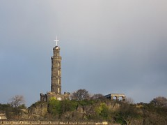 Untitled (Onetaina) Tags: uk trees sky sun reflection building tower architecture clouds scotland rocks edinburgh cross structure