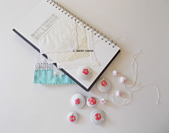 a ledger, hankie corners and fastenings (contemporary embroidery) Tags: beads lace buttons sketchbook ledger hankies fabricbeads
