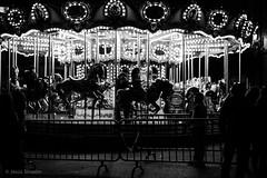 Carousel (Jesús Simeón) Tags: madrid plazasantacruz tíovivo streetphotography blackwhite monochrome nightlife christmas