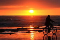 The cyclist (Eduardo Ruiz M.) Tags: seaside coast sunset landscape outdoor sea sky sun ocean beach tranquility bycicle bike backlight santabarbara california pacific orange