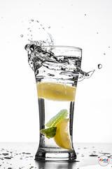 Glass & Water (JoVivek) Tags: glass water splash freeze ice bulb light india tabletop productphotography lemonade glassjar beverage blackwhite adiraimaging vivekjoshiphotography pune lemon mint food