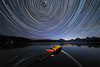 Star Trails over Apgar Lake (Saptashaw Chakraborty) Tags: usa montana glaciernationalpark canon 6d rokinon 1428 summer landscape night nightscape stars startrail longexposyre boats reflection apgarlake lake