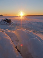 Sunrise flare (Jarno Nurminen) Tags: snow balticsea sea finland nokkala espoo winter ice morning sunrise lensflare