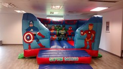 15x12 low height Superhero themed bouncy castle for indoors. £55 per hire.