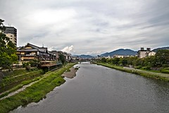 Riverscape in Kyoto, Japan (Johnnie Shene Photography(Thanks, 1Million+ Views)) Tags: city sky people colour macro beautiful japan horizontal clouds canon river lens wonder landscape photography eos japanese rebel dc focus scenery kyoto kiss stream long angle riverside image outdoor no traditional wide scenic sigma tranquility scene modified brook colourful awe distance prefecture 1770 kansai tranquil cloudscape adjustment freshness  foreground majesty selective  x6 wonderlust riverscape fragility 284  650d t4i 1770mm  f284