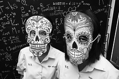 Thai students explaining La Dia de los Muertos (David Gabriel Moreno) Tags: school people blackandwhite students monochrome skulls thailand assignment masks math diadelosmuertos presentation 20mm chalkboard phrae sonye skeletalsystem sel2028