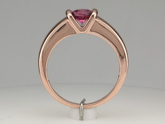 Pink sapphire in rose gold V mounting