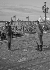 (john g (Birkenhead UK)) Tags: street venice italy woman man girl zeiss candid sony father daughter strangers meeting conversation greeting sanmarco a7rm2 a7rmii