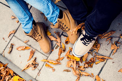 Two Pairs of Feet in Shoes (Image Catalog) Tags: park autumn friends people fall love boyfriend nature students leaves outdoors happy couple friendship teenagers lifestyle happiness romance jeans relationship together romantic lovely publicdomain