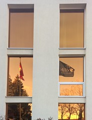 Glattbrugg 18 November 2015 104 (paul_appleyard) Tags: window reflections hotel airport zurich hilton flags reflected