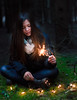 Light In The Darkness (ToMpI97) Tags: dark light sparkle sparkler sparkles forrest forest girl cute beautiful festive holiday pine dense grass moss stars young teen