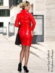 Monique Montiniere in red vinyl jacket and skirt (PVC Fashion) Tags: monique montiniere shiny sexy red pvc vinyl plastic jacket coat skirt suit skirtsuit fashion clothing wear model models beauty women celebrity celebrities lack plastik kleidung frau