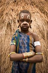 Mursi Girl (Rod Waddington) Tags: africa african afrika afrique äthiopien ethiopia ethiopian ethnic etiopia ethnicity ethiopie etiopian omo omovalley outdoor girl child female mursi tribe traditional tribal culture cultural portrait people hut scarification painted face bangles beads costume