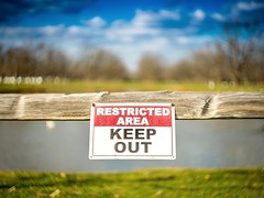 Keep Out. (nytetyme45) Tags: lake clouds sign keepout sun fence color swirly helios helios442 bokeh