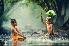 Childrens playing in the river (Bee-Teerapol) Tags: outdoor wet thailand two fun fantastic enthusiasm boy expression happiness active indonesia summer myanmar people sun poor caucasian muscles cute recreation funny lifestyle local strength face standing malaysia person laos rural laugh sunset joy kid play fresh child water space cambodia vietnam vacation asian splash sport happy rustic summertime aec