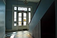 Grand Staircase (mtoscor) Tags: door school dusty abandoned broken stairs chair classroom urbandecay neworleans creepy spooky decrepit victorianarchitecture grandstaircase urbex checkeredfloor emptyclassroom abandonedschool beautyindecay mcdonogh23
