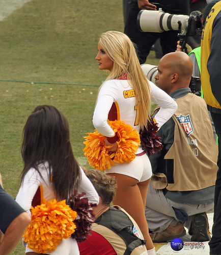 Redskinette Cheerleader Jade Kenny watches the play...
