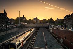 Destination Sunset (Gilderic Photography) Tags: city sunset church station train lumix belgium belgique belgie horizon rail panasonic liege ville gilderic lx3 dmclx3