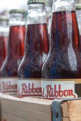 Red Ribbon (rand0m05) Tags: bottle bottles redribbon drink pittsburgh bottlecap glass glassbottle
