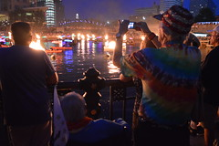 Theresa Irene Wolowski and Randy Randolfe Wicker recording video of WaterFire Providence light up Clear Currents Japanese Koi Fish canoe boats paddling on the river in Providence RI Rhode Island USA (RYANISLAND) Tags: waterfireri waterfirerhodeisland waterfire providence providenceri providencerhodeisland barnabyevans barnaby evans rhode island rhodeisland ri rhodeislandstate newengland us usa america american rhodeislanders publicart art downtownprovidence 2015 visitprovidence goprovidence iloveri iloverhodeisland visitrhodeisland fire flames bonfire outdoorfire fireart artfire fuego llamas discoverrhodeisland visitri cityofprovidence cityofprovidenceri city