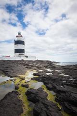 Hook Head Lighthouse (tripleloutz) Tags: ocean travel ireland summer sky lighthouse water clouds canon landscape boat rocks alga irlande algue
