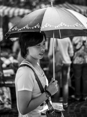 Summer Shade   Umbrella against the heat (Markus Immerheiser) Tags: street summer portrait woman hot girl umbrella asian asia warm market sommer streetphotography portrt heat markt heis regenschirm schirm cinematicstreetart