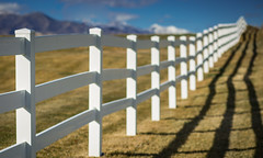 a glimpse into the distance (auntneecey) Tags: mountains fence bluesky whitefence
